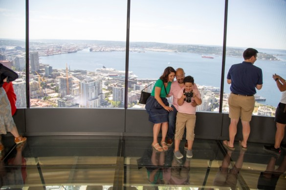 Family enjoys The Loupe - the world's first revolving glass floor. Courtesy of John Lok and Space Needle LLC