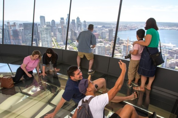 Guests take selfie on The Loupe - the world's first revolving glass floor. Courtesy of John Lok and Space Needle
