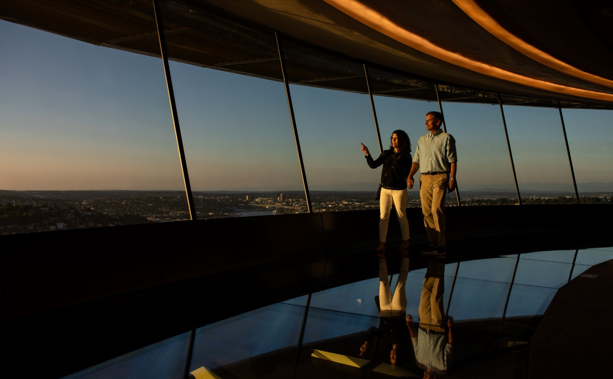 Walking on the world's first revolving glass floor at The Loupe. Courtesy of Space Needle and Rod Mar