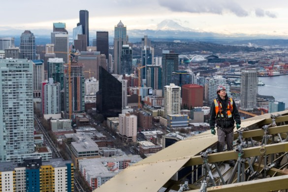 Worker out on the Space Needle 'Halo' during renovation. Photo credit Rod Mar