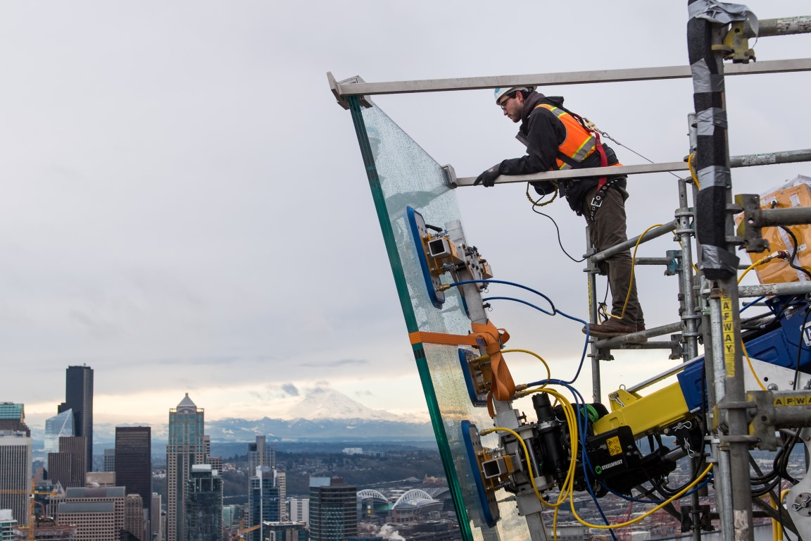Workers install 11 foot glass walls on Seattle Space Needle Observation Deck -courtesy Rod Mar