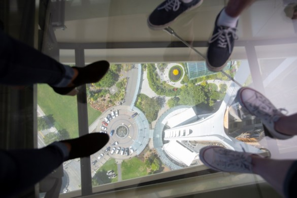 Guests step out onto The Loupe - Space Needle revolving glass floor. Courtesy of John Lok and Space Needle LLC