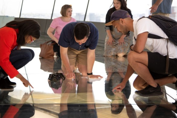 The Loupe - Space Needle guests experience the world's first revolving glass floor located 500 feet in the air