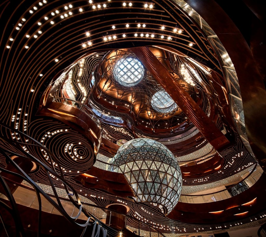 "View of the atrium, known as 'Opera Theatre', the Oculus"" and Gold Ball, an interactive space, designed by KPF, AB Concept, Speirs + Major, and LAAB Architects using generative design. Image © K11 Group"