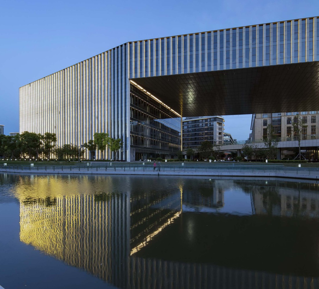 Gate of Linkong with reflection on water. Image Courtesy of Aedas