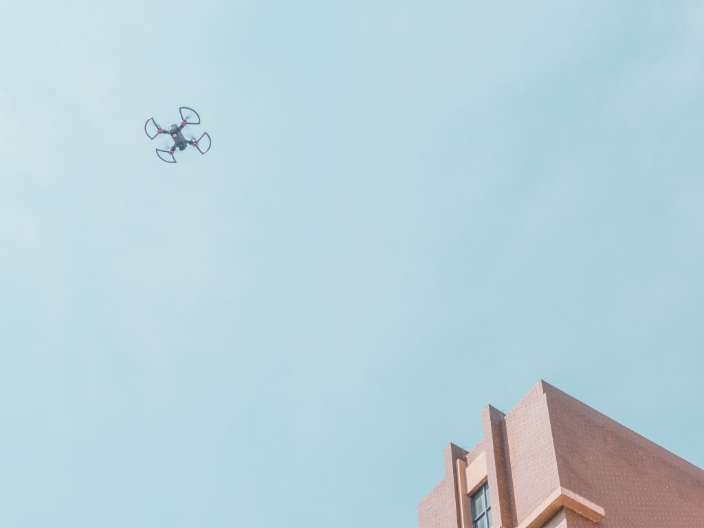Buildings will need to adapt to consumer expectations of new technologies, such as drone deliveries. (Credit Photo by Valentin Lacoste on Unsplash)
